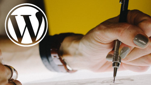 WordPress logo with a hand planning out websit content on paper